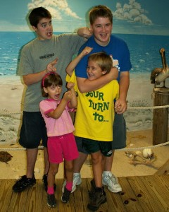 The Nixon kiddos acting goofy (as usual) at the Biloxi Aquarium.